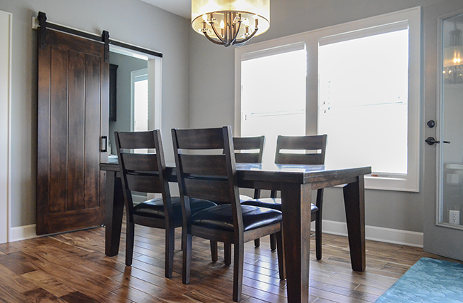 Transitional dining area in new custom home